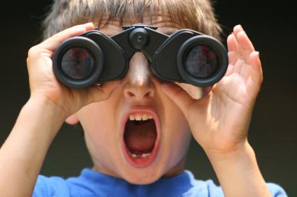 boy with binoculars shouting